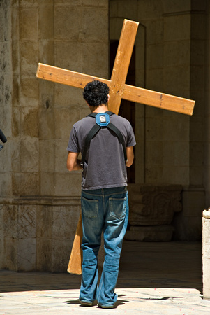 Carrying his cross.